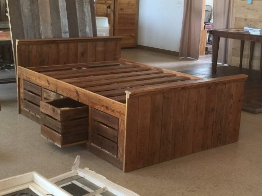 Bed with sliding drawers